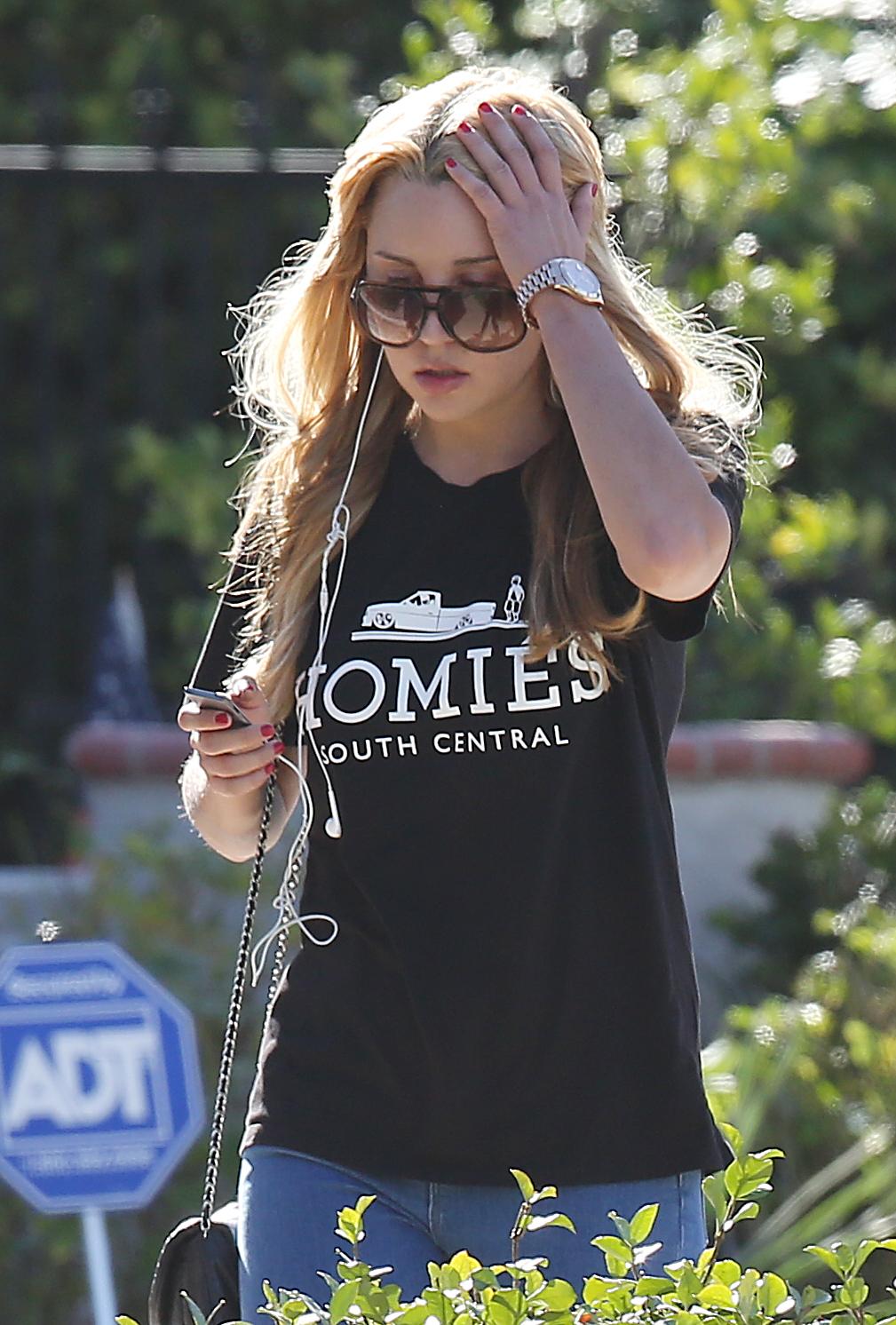 Amanda Bynes takes a morning walk around her neighborhood