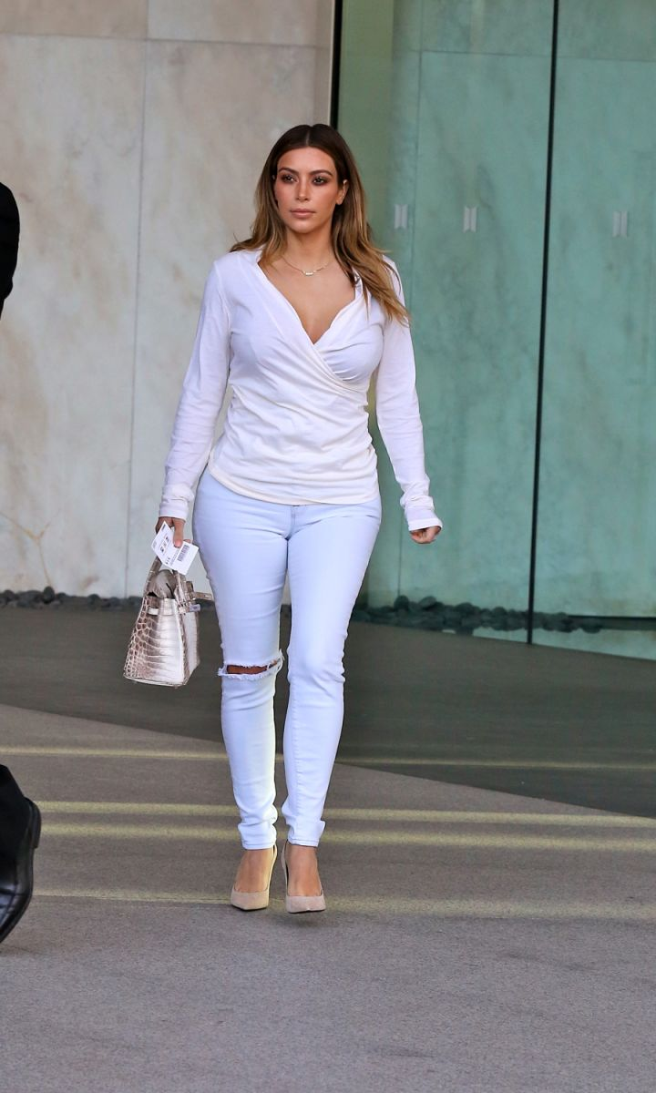 Kim knows how to dress up a pair of jeans….