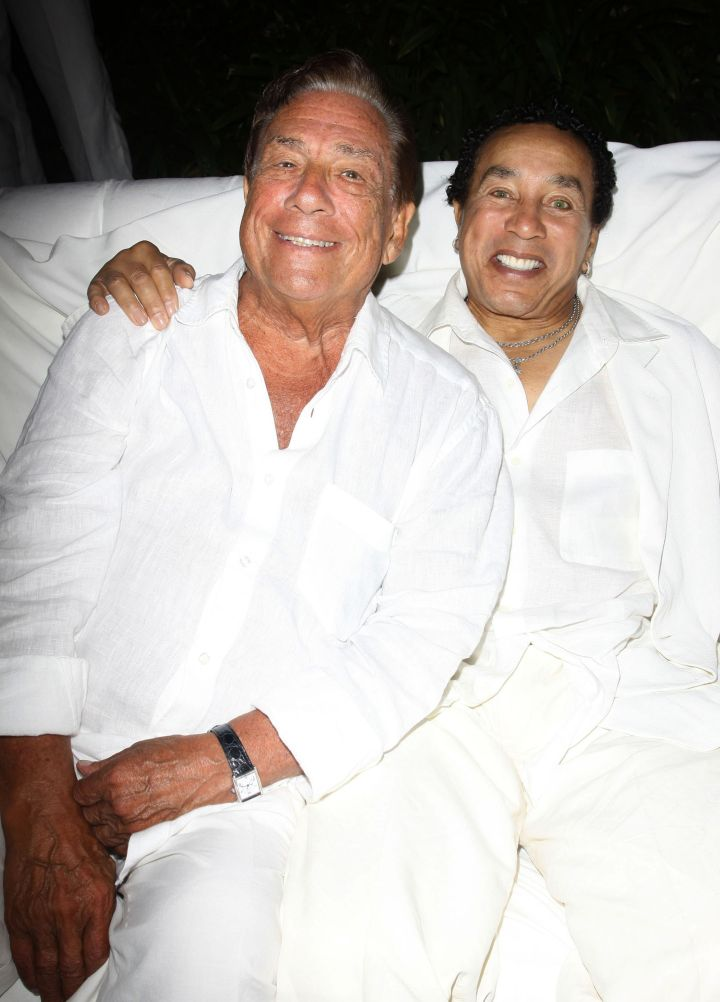 Donald Sterling and Smokey Robinson get close at an all white party for Fred Segal's birthday party.