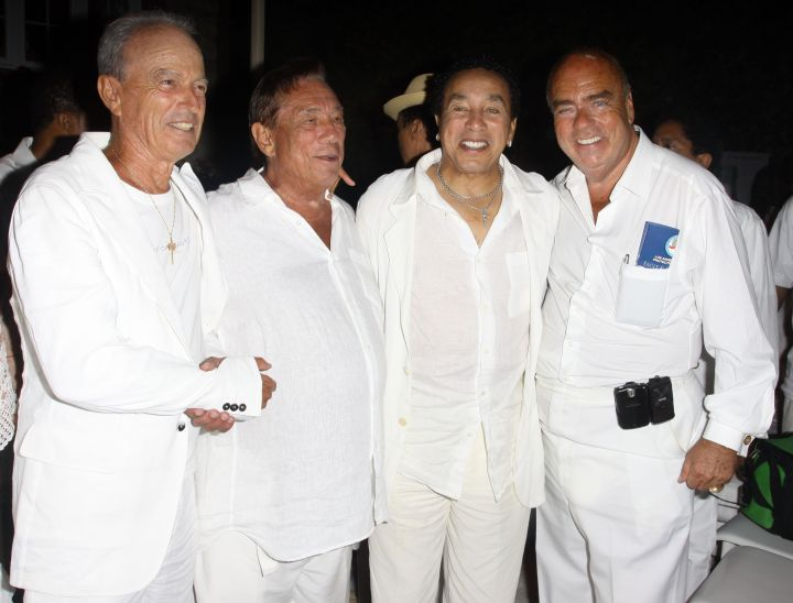 Donald Sterling and Smokey Robinson hang out with friends at an all white party.