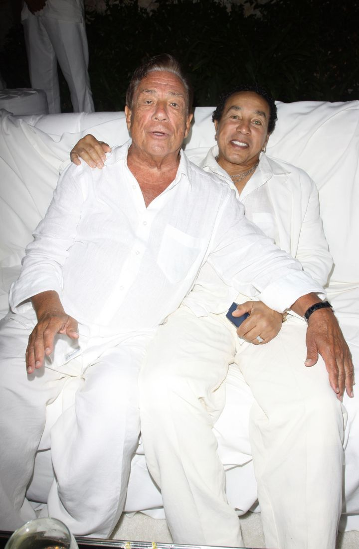 Donald Sterling and Smokey Robinson get close at an all white party.
