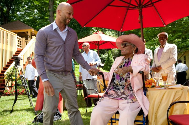 """Maya Angelou pictured with rapper Common at her 82nd birthday. Common has been vocal about her influence, releasing """"The Dreamer"""" in 2011 featuring the poet."""