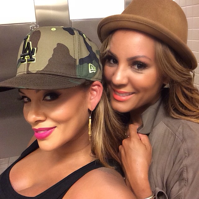Evelyn Lozada and friend take a bathroom selfie.