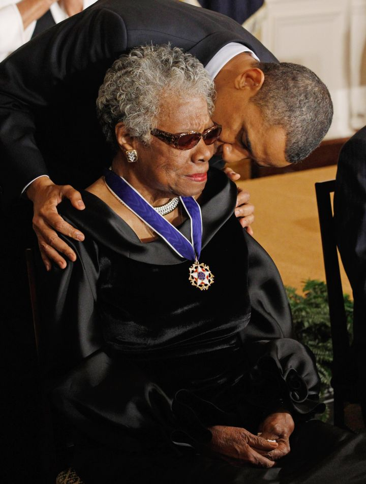 President Barack Obama kisses poet and author Maya Angelou after giving her the 2010 Medal of Freedom.