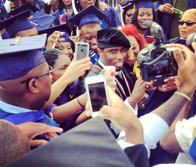 Diddy is surrounded by tons of HU students at their commencement ceremony!
