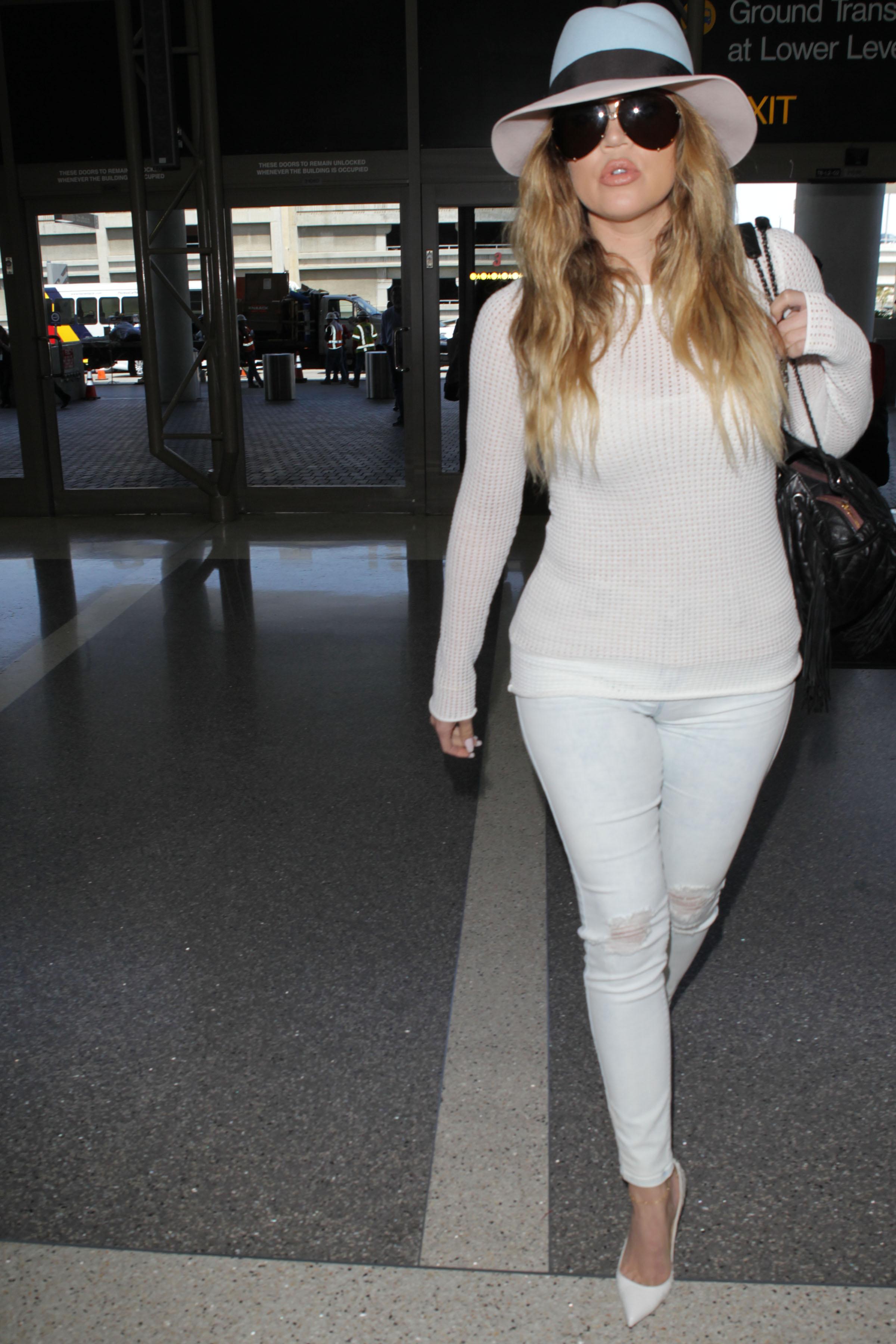 Khloe Kardashian leaves for Kim's wedding in Paris