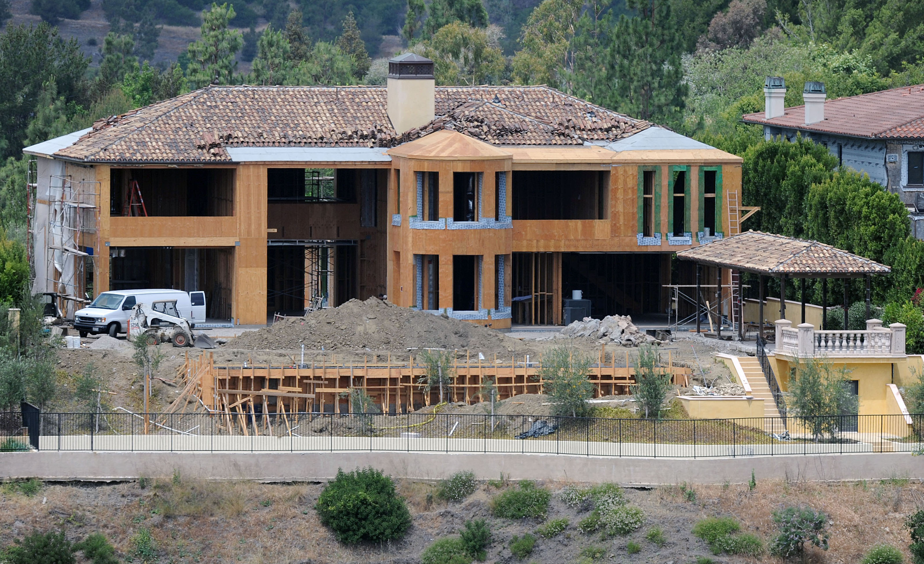 'Kimye' might have just got married but they can't move into their new house as it's STILL being built! LA