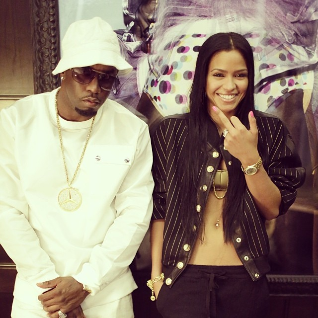 Cassie cheesing like Diddy makes her the happiest girl in the world. Look at that smile!