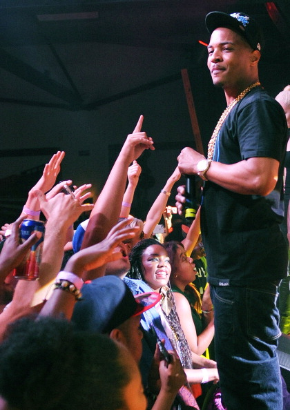 T.I. performing for a crowd.