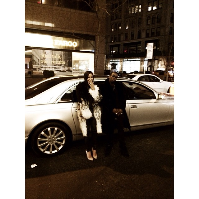 Champagne sippin', NY livin'. The lovebirds posted up in front of the whip.