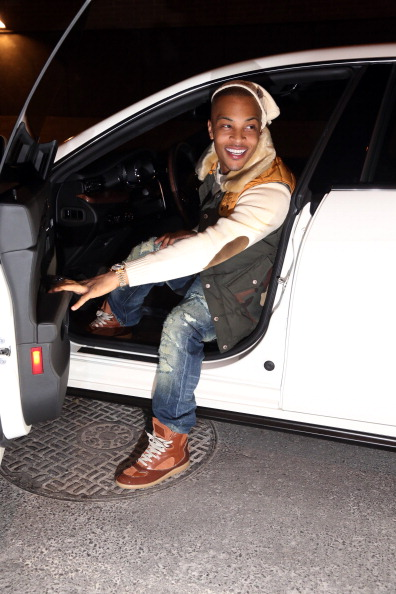 T.I. stepping out of his car.