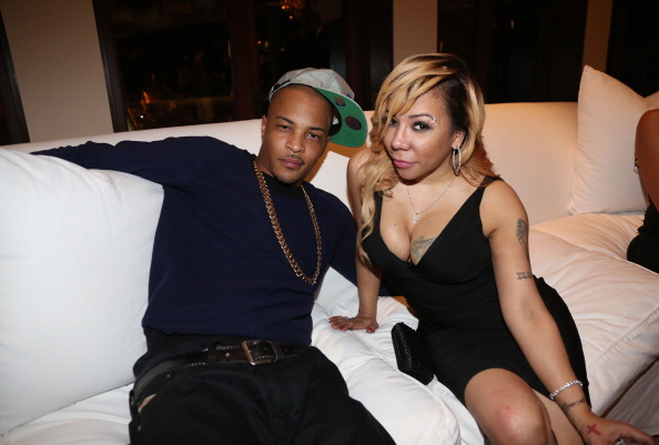 T.I. and wife Tiny pose for a picture.