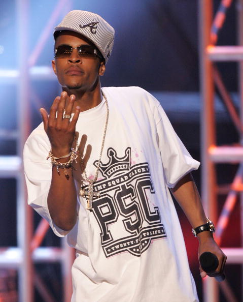 T.I. performs at the BET Awards with a gray fitted, sideways.