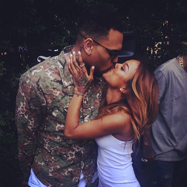 Chris Brown and his ride-or-die Karrueche Tran share a kiss at his welcome home party.