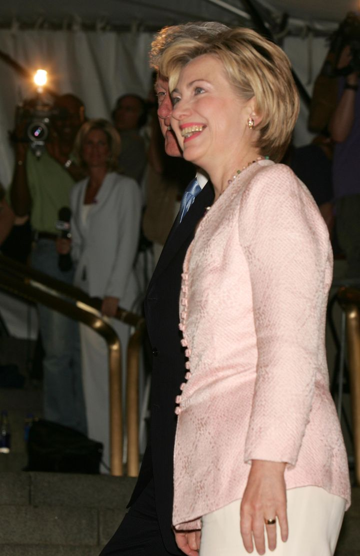 June 2004: Hillary's lighter looks were always welcoming, but the lace embroidered pattern was a standout during an appearance with Bill Clinton in New York.
