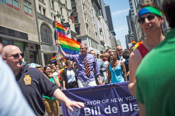 NYC Mayor Bill de Blasio walks the lavender line in the Pride parade.