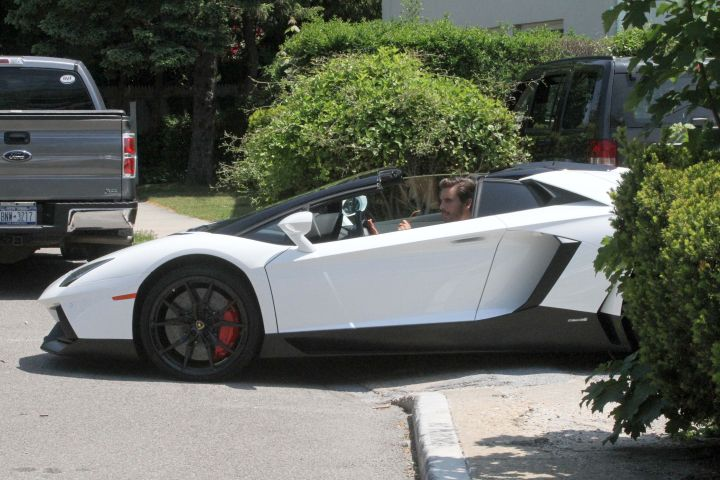 Fast! Scott Disick is seen driving his Lamborghini today in The Hamptons, New York.
