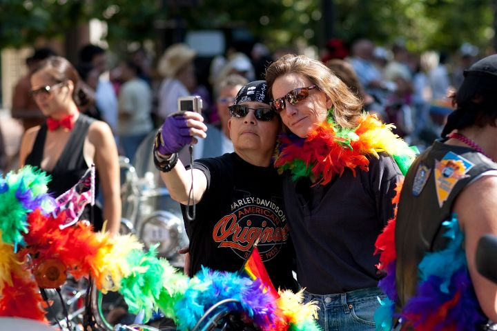 Parade-goers stop to take an 'usie' in San Francisco.