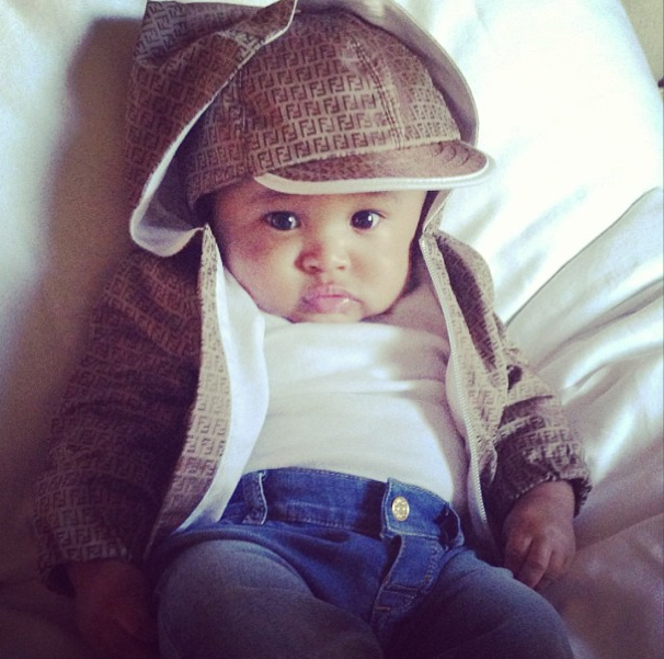 Cairo's stylin' on 'em in his Fendi outfit.