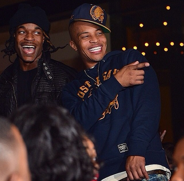 T.I. laughing with friends.