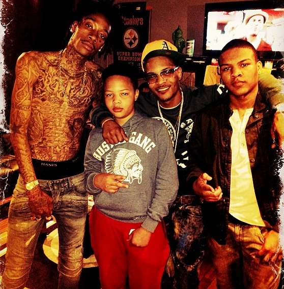 Wiz Khalifa, T.I. and his two kids in the studio.