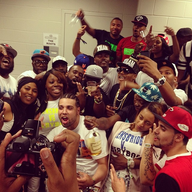 Nas posed with his Queens family backstage.