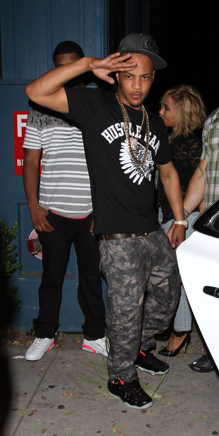 T.I. representing his team with a Hustle Gang tee.