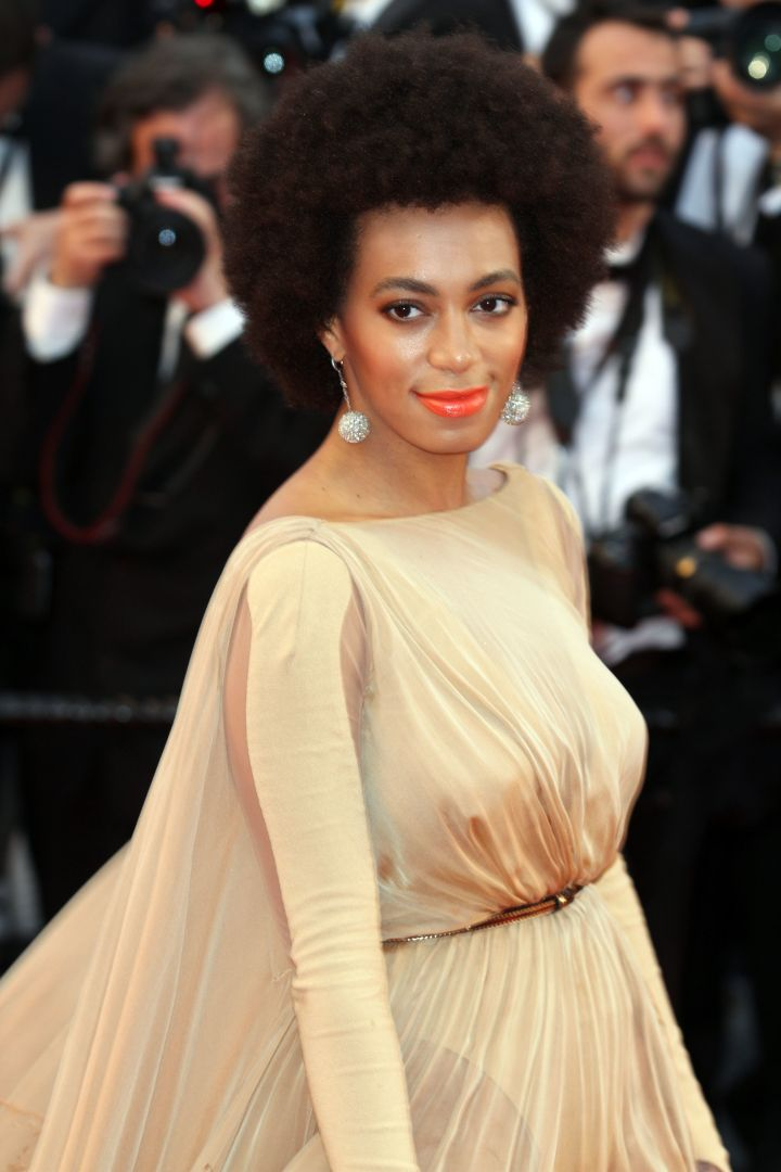 Solo brought in 2013 with her reliable afro.