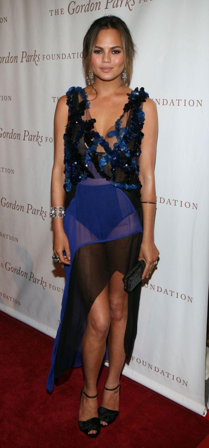 Chrissy Teigen Wears High-Waisted Bottoms Under Her Sheer Skirt.