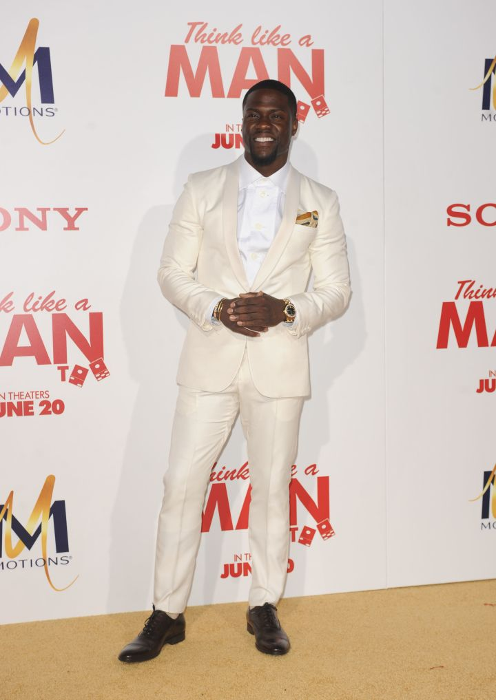 Kevin Hart opted for a cream-colored suit and an air tie.