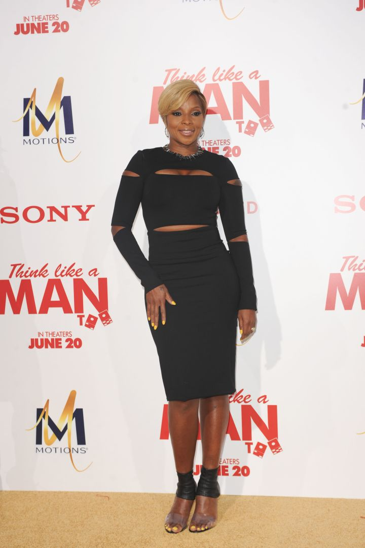 Mary J. Blige gave us a little peep show in a slashed tight black dress.