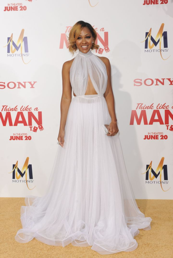 Meagan Good waltzed down the red carpet in a flowing Michael Costello creation.