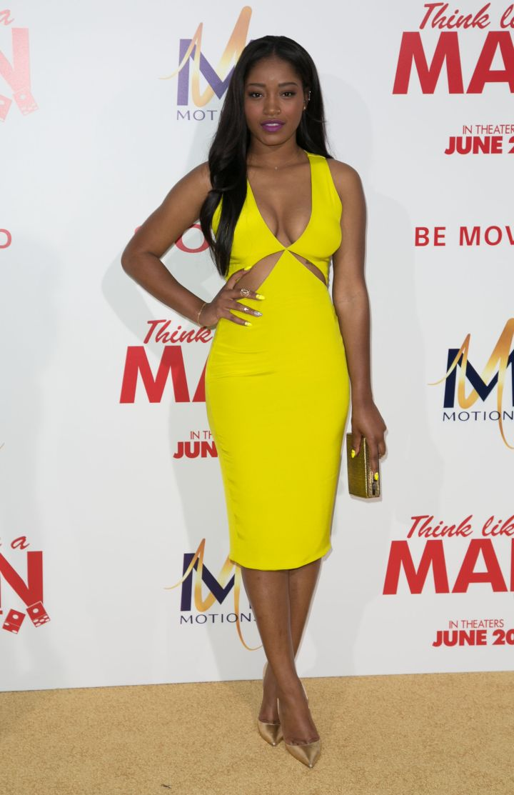 Keke Palmer played with a color in a canary yellow cutout dress paired with a purple lippy and gold pumps.
