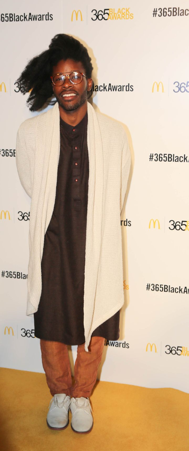 Jesse Boykins III walks the golden carpet at the McDonald's 365Black Awards in New Orleans.