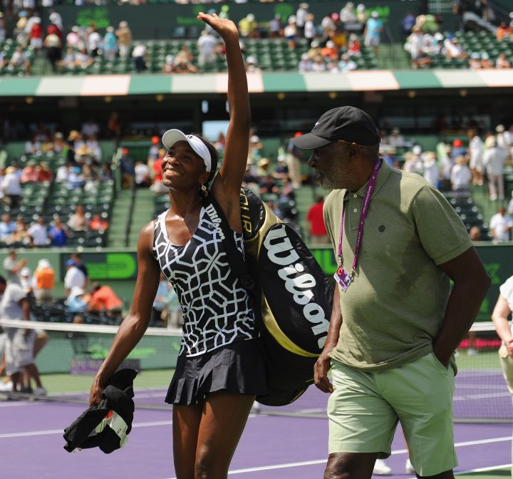 Venus waves to her peeps in 2012 with her dad.