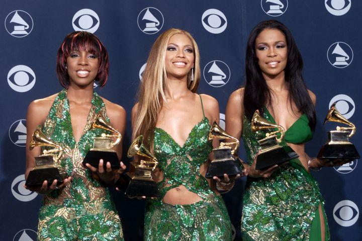 Six hands, six Grammys.