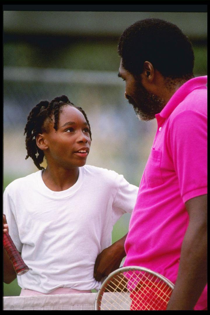 Venus Williams talks with Richard Williams on the tennis court in 1990.