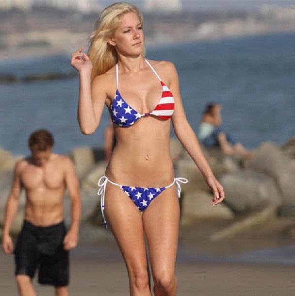 Heidi Montag sporting her American flag bikini on the beach.
