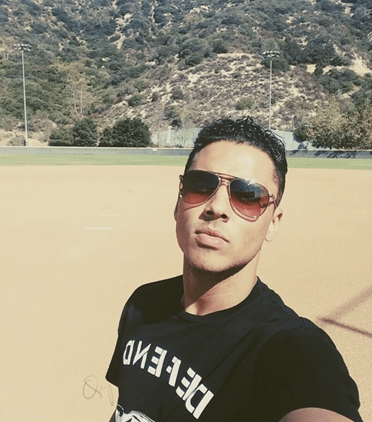 Quincy takes a selfie on the field before the game