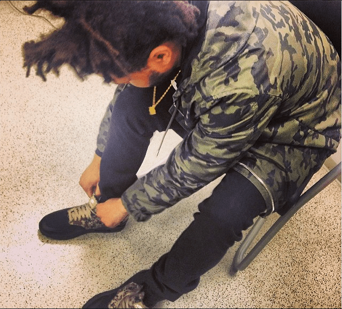 The Weeknd Ties His Own Shoes
