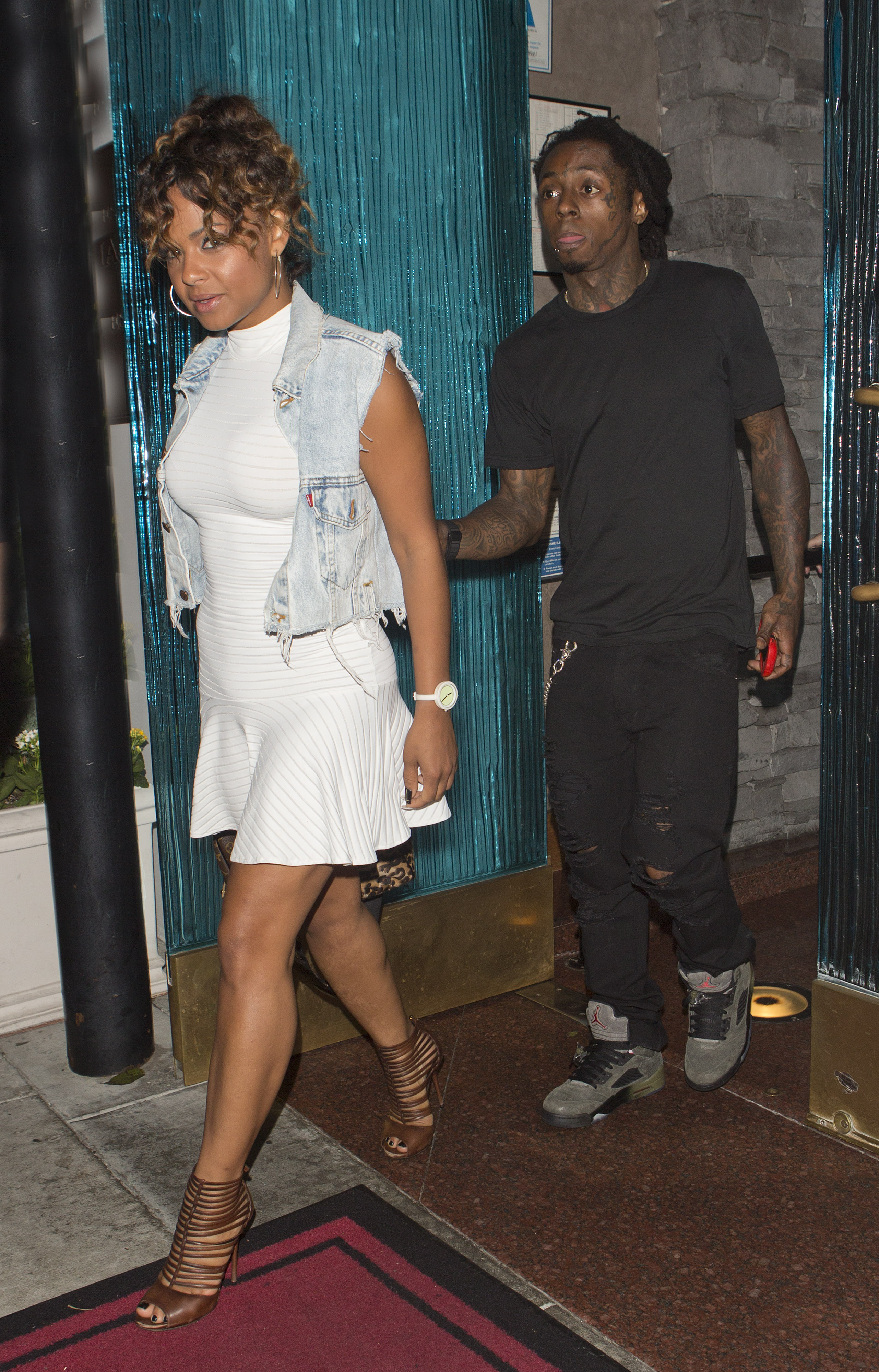 Rapper Lil Wayne and fellow singer Christina Milian were seen leaving Mastros Steakhouse restaurant in Beverly Hills, CA