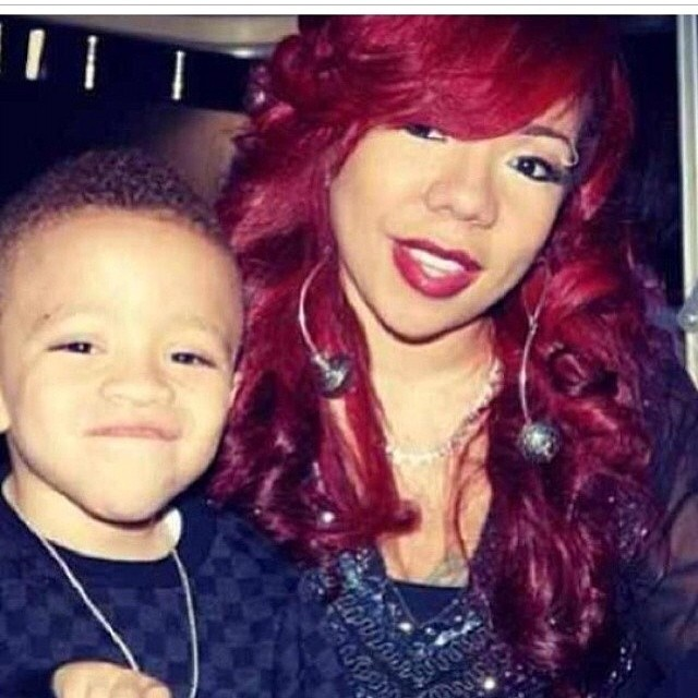 A red haired Tiny is all smiles with young King.