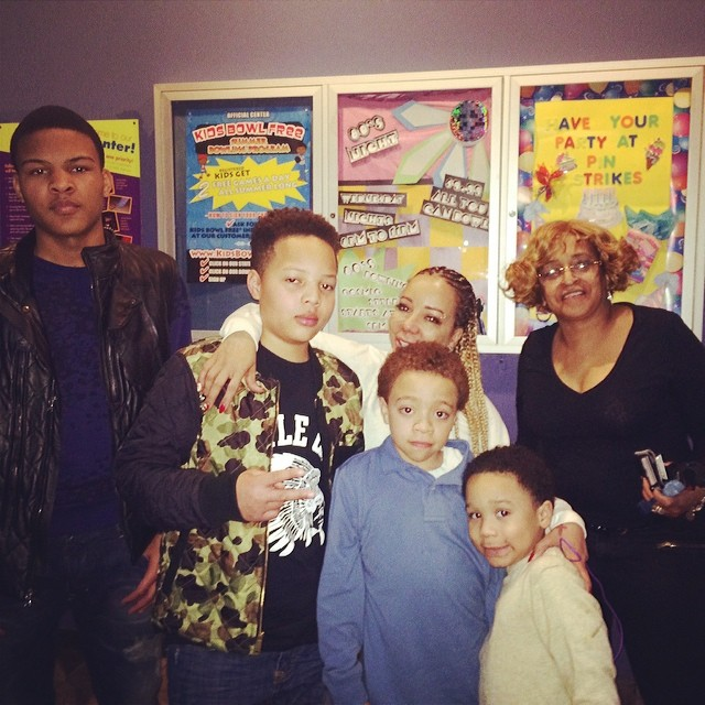 Tiny posed with her kids and T.I.'s sister.