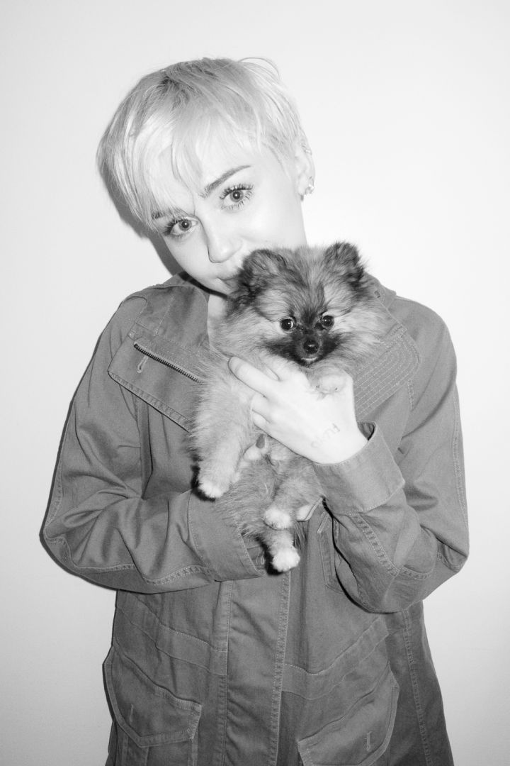 Miley Cyrus and her puppy pose for Terry Richardson.