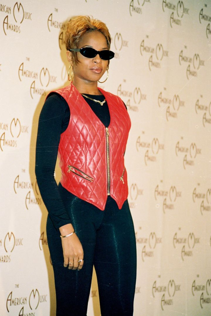 Mary looks flawless in a red leather vest.