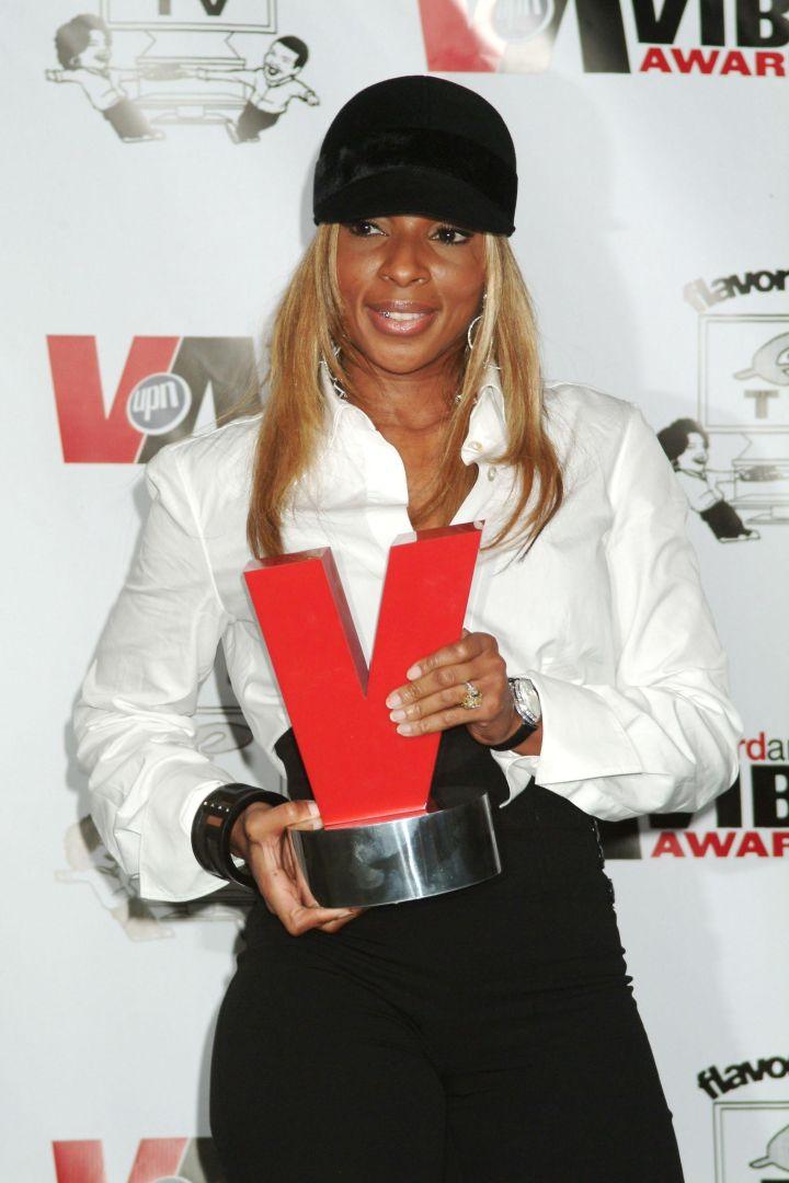 Mary accepting a VIBE award.