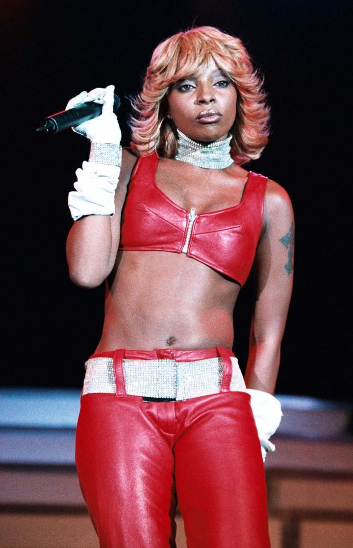 Whoa, MJB is fiery in her red hair and a matching red leather ensemble.
