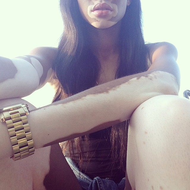 All gold on her wrist.