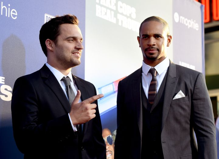"""Jake Johnson and Damon Wayans Jr on the red carpet of the """"Let's Be Cops"""" Premiere in Los Angeles."""