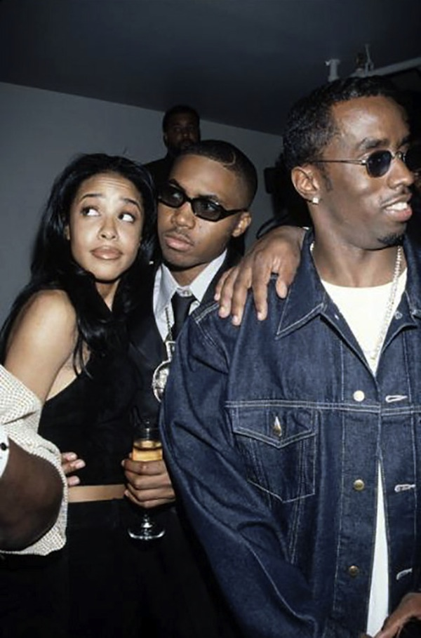 Aaliyah kicks it with Nas and Diddy.